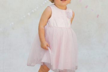 Ärmelloses Babykleid für Mädchen rosa bedruckt/beige glanzeffek