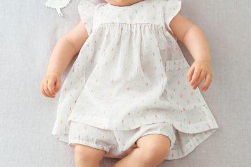 Baby-Set aus Kleid und Babyhose gold bedruckt