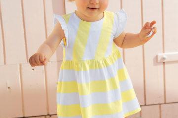 gestreiftes Mädchenkleid für Babys gelb gestreift